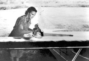 MAF Missionary pilot, Betty Greene does plane maintenance